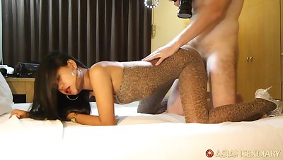 Foreigner picks up and fucks amateur Asian call-girl in ripped bodystockings