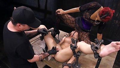 Unadorned metal is keeping this helpless slavegirl in place